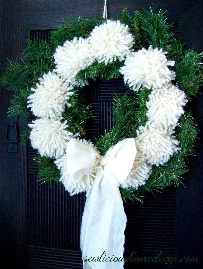 Make a Pom Pom Wreath with yarn tutorial at sewlicioushomedecor.com