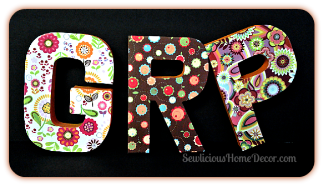 Scrapbook covered paper mache letters at sewlicioushomedecor.com