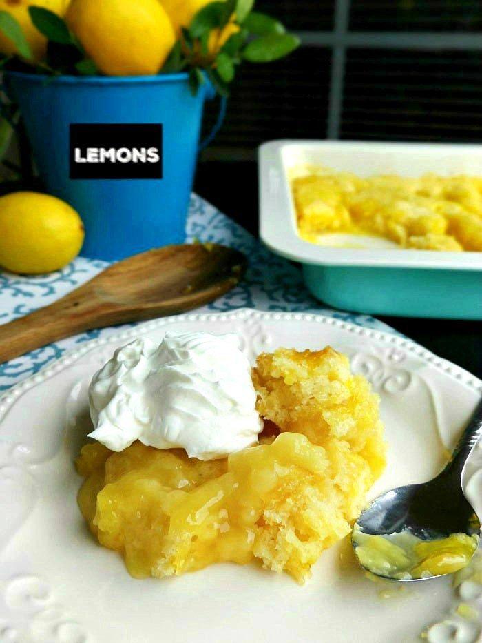 Best-Lemon-Pudding-Cobbler-Cake-Recipe-topped-with-Cool-Whip-sewlicioushomedecor