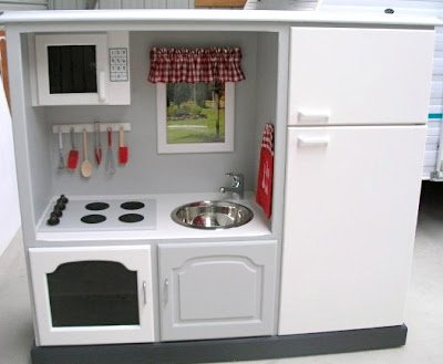 Recycled entertainment center play kitchen with stove top and refrigerator