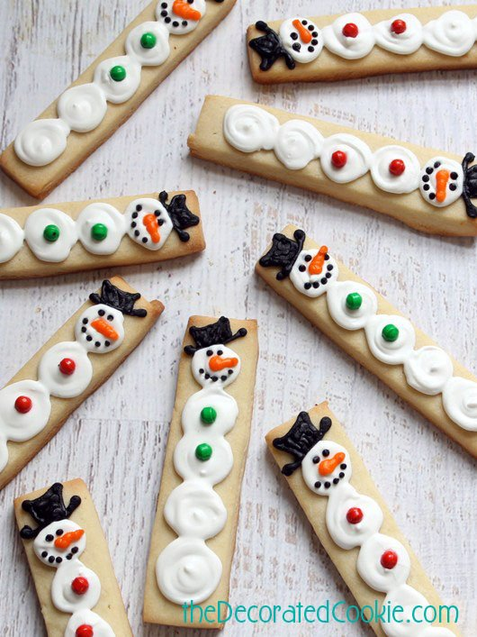 snowman cookies on a stick