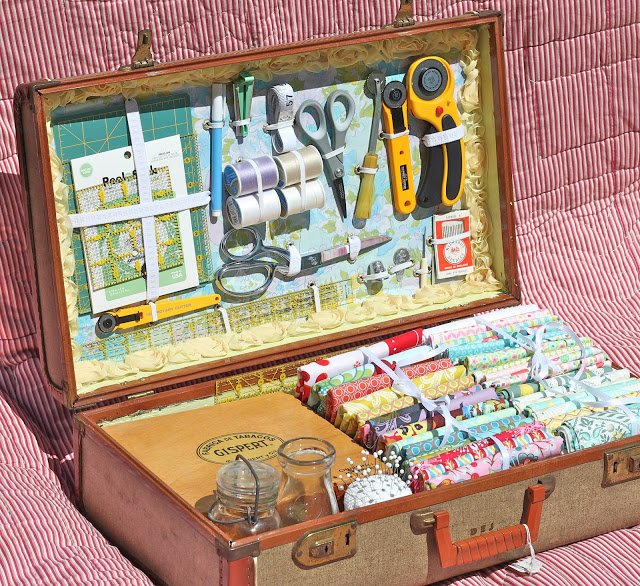 A recycled suitcase turned into a sewing kit.