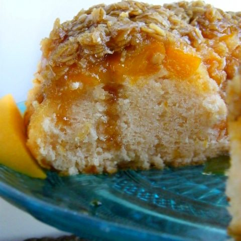 Best Buttermilk Peach Cobbler Cake Topped with Crumbled Oats Caramel Sauce and Ice Cream